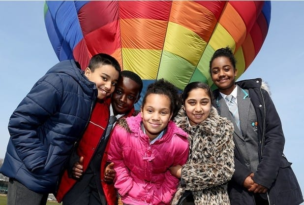 IN PICTURE: (L- R) Pupils from Radford Academy prepare for a hot air balloon ride at The Forest Recreation Ground. Pictured from the left is: Sukharj, Mohammed, Victoria, Simmi and Zannecia.