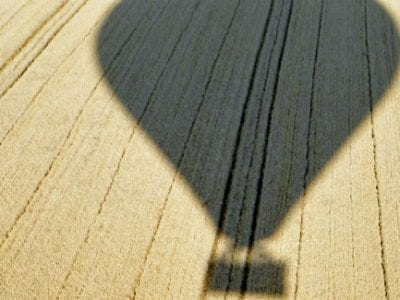 Hot Air Balloon Silhouette on corn field